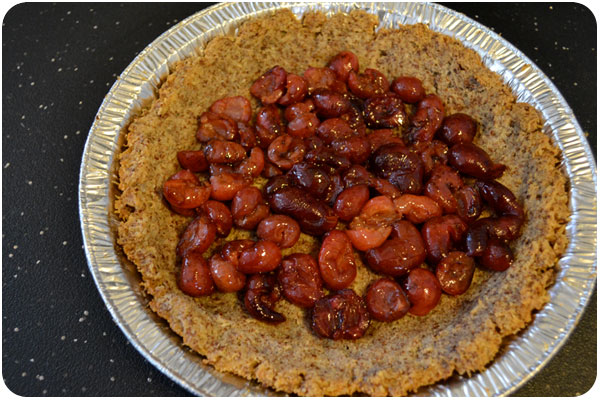 roasted cherries line the pie crust
